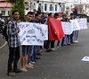 Java East-Malang City Protest 20171211_104129 DSCN0339 (CanadaGood) Tags: asia asean seasia indonesia indonesian java eastjava jawatimur malang building cityhall tree people person protest sign canadagood 2017 thisdecade color colour javanese red