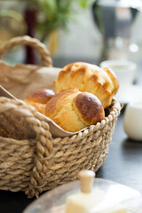 Close up view of brioche buns in a basket (ksenee) Tags: bake bakery basket bread brioche brown bun butter classic closeup coffee delicious dough fluffy french fresh golden homemade lunch meal milk morning pastry sweet tasty traditional vertical yeast