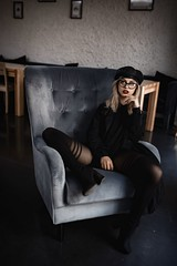 The Woman In Black (ClvvssyPhotography) Tags: provacative person clvvssyphotography people indoors poses glasses chair sitting woman blackclothing style fashion beauty portrait