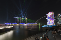 iLight Marina Bay from Merlion Park (tapanuth) Tags: marinabay merlion ilight lightshow marinabaysands hotel landmark cityscape laser park waterfront singapore night travel tourism attraction asia southeastasia sightseeing event 2018 dusk evening illuminated reflection nightlife bridge modern architecture animal symbol country