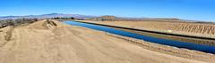 Canal Surrounded by Desert (joe Lach) Tags: antelopevalley california fairmont blue brown californiaaqueduct flowingwater joelach mohavedesert mojavedesert river runningwater stream dirtroad dirt