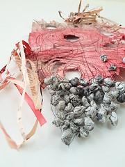 i wish it was true (Ines Seidel) Tags: news newspaper texture pattern wish red shape form sewing yarn stitching holes zeitung zeitungspapier nachrichten true wahr