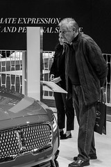 Admiring the Lincoln Continental (dharder9475) Tags: 2018 bw blackandwhite candid chicagoautoshow lincolncontinental man privpublic stranger streetphotography