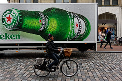 Big Bottle (Alfred Grupstra) Tags: editorial people street bicycle urbanscene men citylife cycling outdoors sign city business truck