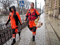 Krakow -3274163 (Neil.Simmons) Tags: poland krakow streetphotography people street day woman man orange hiviz emergency services bread