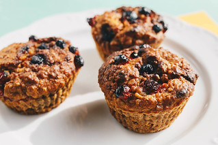Homemade muffins with forest fruits. Close up.