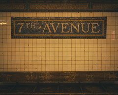 A wood bench and a sign of the 7th avenue subway station in Brooklyn, New York. (pedroferr) Tags: wood lines usa metro bench seventh moody lowlight subway brooklyn urban unitedstatesofamerica tile classic seven 7 vintage newyorkcity old avenue 7th sign yellow station dramatic color horizontal