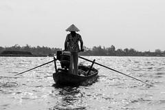 On the Mekong river (Roberto Bendini) Tags: vietnam hanoi ho chi minh saigon mekong river boat boatman bateau barca battelliere blackandwhite canon