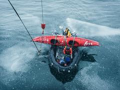 Offloading in snow (Gerry Lefoe) Tags: green ocean nova oceannova snow ice antarctica kayak red