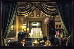 a short story about windowpane in the frame (ignacy50.pl) Tags: citylife glass restaurant people lamp cafeteria evening city street streetphotography colorful praque czechia