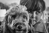 Best Friends (jayneboo) Tags: norah poopy mono bw pets friends leica cl 1856 dog granddaughter hugs love nik