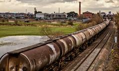 Oil tanks pass through Clay Mills (Peter Leigh50) Tags: oil tanks train railway railroad rural rail water