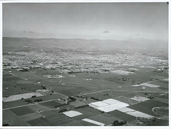 Aerial view of Palmerston North Airport with City in the background (Archives New Zealand) Tags: archivesnewzealand archives archivesnz nationalpublicitystudios aotearoa tourism newzealand newzealandhistory nz nzhistory history