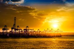 sunset over harbour (K.H.Reichert [ not explored ]) Tags: hafen cranes ship sea sunset wolken clouds sonnenuntergang sky malta schiffe kräne harbour marsaxlokk containership
