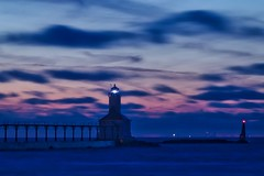 The Chicago skyline as viewed from Michigan City, Indiana (Symbiosis) Tags: chicagoil michigancity michigancityindiana lighthouse michigancitylighthouse sunset lakemichigan chicagoskyline chicagoskylineasviewedfromindiana skyscrapers redsky redskies cityscape citiscape architecture pier trumptower trumpinternationalhoteltower searstower johnhancockcenter