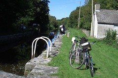 Cycling by the Barrow River (Diepflingerbahn) Tags: riverbarrow boris countycarlow bicycles canoe lock lockkeeperscottage qvr41 ireland