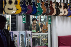 Guitars (ghostwheel_in_shadow) Tags: america arequipa peru southamerica architectureandstructures artcultureandcraft commercialarchitecture guitar instrument music profession publicarchitecture shop shopkeeper store tradesman pe