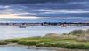 Black House, Black Skies (nicklucas2) Tags: beachhut harbour christchurch sea sand pebble sunrise cloud boat buoy