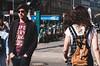 Missed Chances (The Street Sniper) Tags: europe mirrorless xe3 fujifilm fuji 1855mm kitlens urban city walking indifferent sunglasses brille deutschland germany ubahn berlin streetphotography street boy girl hackerschermarkt