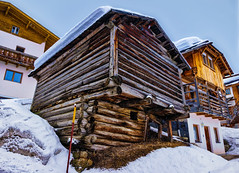 Wooden (Мaistora) Tags: corvara altabadia dolomites alpes italy mountain winter building architecture wood wooden shed barn chalet hut villa alpine classic typical snow skiing hill steep slope uphill perspective angle pov viewpoint color colour brown yellow orange honey caramel pine pinewood log logs beams roofs windows structure design construction skyline sky blue white light shadow contrast hdr lightroom aurora