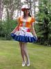 Dutch frilly skirt (Paula Satijn) Tags: sexy hot dress skirt cute lovely sweet girl gurl tgirl tranny dutch red white blue orange garden outside hat frills ruffles sensual fun joy happy girly feminine legs stockings shiny silky silk smile adorable apron