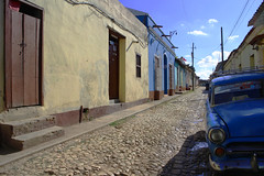 Alone in the town, in the heat (Le.Patou) Tags: cuba trinitad alone seul voiture car désert deserted spot country countryside village street rue streetscape scènederue streetview streetscene
