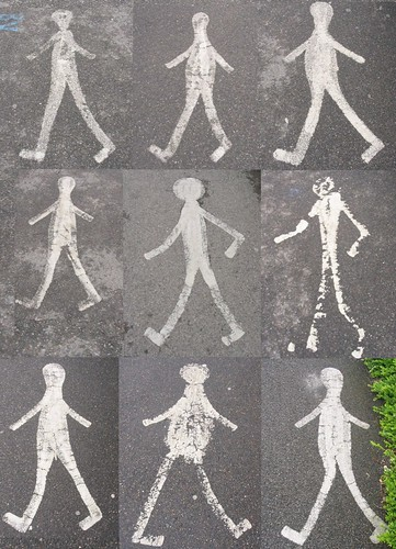 graffiti of stick figure walking, nine different figures in a square, some walking in the opposite direction