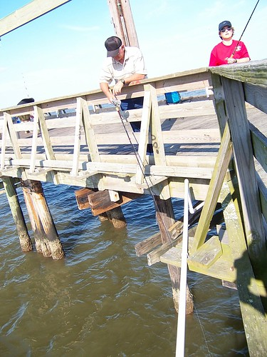 Fishing from a pier at Grand Isle