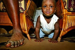 killian emerging next to his dad's foot (phitar) Tags: 2003 africa travel kids topf50 topf75 benin galleria phitar 3000v120f