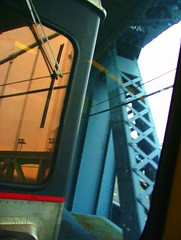 tilted (Miss Plum) Tags: commuting patco train travel benfranklinbridge reflection