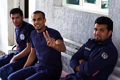 Ladder 49 (miskan) Tags: kuwait nikon d70 digital 50mm camera middleeast gulf asia firemen fireman firefighters fire ladder49 peacesign uniform meninuniform 3guys 3men