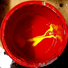 Red Paint with Splash of Yellow