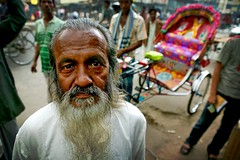 long beard and colourful rickshaw (phitar) Tags: travel portrait color men topf25 wow asia topv1111 dhaka rickshaw bangladesh phitar