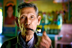 smoking the pipe in a buddhist monastery - portrait pipe smoking man asia travel burma myanmar phitar bilugyun buddhist monastery