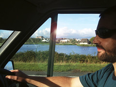 beardymattdrivingradipole (theonewhoistall) Tags: houses lake man grass sunglasses birds clouds matt beard driving august 2006 greenery weymouth radipole theonewhoistall
