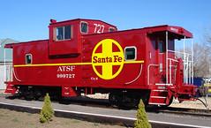 Bright red Santa Fe caboose.