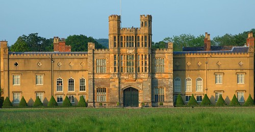 Coughton Court has an impressive west front which is shown at its best in the warm evening light. (Photo by Kate & Drew on Flickr: Click image)