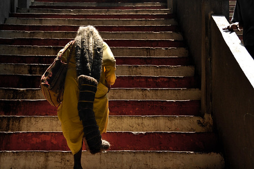 A 94-year-old woman ascends the final stairs in the 272-step ascent in the Batu Caves