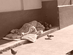Homeless sleeping _n the sidewalk