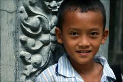 Khmer Smile: Temple Boy (mboogiedown) Tags: travel boy smile children asian temple asia cambodia cambodian khmer child young culture shy siem reap southeast angkor wat  pajamas cultural     kampuchea  mapcambodia  cambogia theravada khmersmile  travelforpeace camboge futuremonk soksabay beatravelernotatourist dontjustseetheworldexperienceit experiencecambodia buddhistnations ifthephotographerisinterestedinthepeopleinfrontofhislensandifheiscompassionateitsalreadyalottheinstrumentisnotthecamerabutthephotographer~evearnold