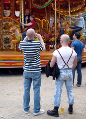 The Photographer, The Skinhead And The Gallopers (ClydeHouse) Tags: carnival gay manchester photographer boots fairground market roundabout carousel pride gaypride skinhead whitworthstreet byandrew gayvillage gallopers