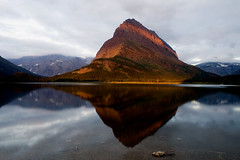 Hide and Seek (Robby Edwards) Tags: vacation lake mountains water tag3 taggedout clouds sunrise weird nationalpark bravo montana tag2 tag1 quality glacier glaciernationalpark payitforward swiftcurrentlake manyglacier specland specnature grinnellpoint abigfave 123f100