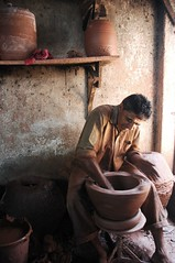 Clay needs shaping (lecercle) Tags: life people india clay bombay mumbai potters preparations dharavi kumbharwada
