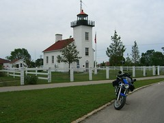 A lighthouse: Lake Michigan Circle Tour (shrosa814 (returning soon)) Tags: lighthouse motorcycle thequeen suzukisv650 lakemichigancircletour solorider femalerider packedmotorcycle femalesolotourer bluesuzuki