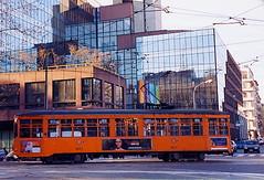 Vecchi tram e nuovi palazzi // Old trams and new buildings (La minina) Tags: italy milan contrast reflections milano tram riflessi oldtram corsosempione modernbuildings contrastotravecchioenuovo palazzimoderni gettyimagesitalyq1