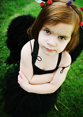 Moody Angel ({amanda}) Tags: girl angel kid mood moody sigma naturallight grouch blackdress 18mm wreathe fouryears blackwings amandakeeysphotography