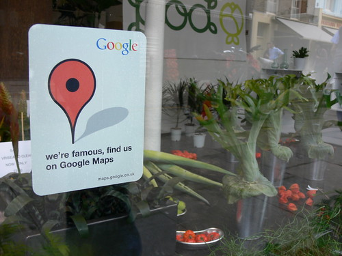 Sign in a window 'We are famous find us on Google maps' photo by Larsz