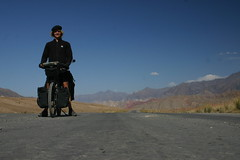 Nicolai on the deserted road going up to the Taldyk Pass at 3630m. Kyrgyzstan.