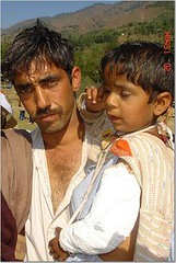 A portrait colored with agony (Edge of Space) Tags: pakistan portrait earthquake dad father son kashmir postearthquake earthquake05 oneyeareq05