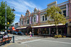 Architecture of Timaru (Jocey K) Tags: newzealand nikond750 southisland timaru buildings architecture trees sky clouds street road crossing shops seats bench cars people